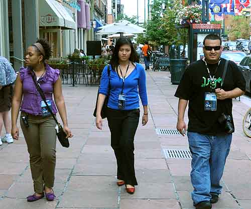 Kisha Allison, Jacqueline Fernandez and Jonathan Mena cruising Denver streets looking for a good restaurant.