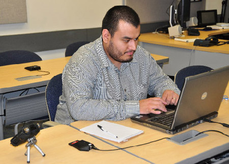 Jonathan Mena, a former WORD Senior Editor-Producer, posting information on Facebook during the September 27, 2010, conference call. ICIT's Distance Learning, for whom Mena now works, made possible the WORD's participation. Mena is officially graduates this semester.